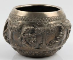 A Burmese white metal bowl, featuring repousse deity figures and repeat pattern borders, unmarked,