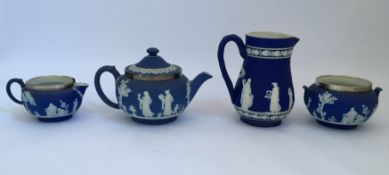 A selection of Wedgwood jasperware, two jugs, bowl and teapot. IMPORTANT: Online viewing and bidding