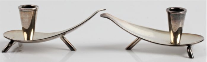 A pair of silver plated Carl Frederik Christiansen Danish candlesticks of tear drop shape, stamped