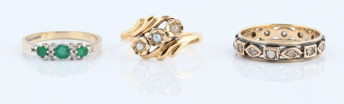 A hallmarked 9ct yellow gold emerald and diamond ring, ring size N, together with a three stone