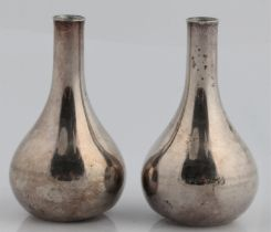 A pair of Jens Quistgaard for Dansk Designs weighted taper stick or candle holders, marked DANSK.
