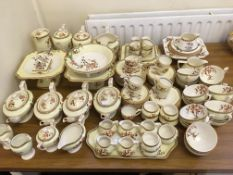 An approx. 100 piece Crown Ducal tea and coffee service in blossom tree on yellow background design,