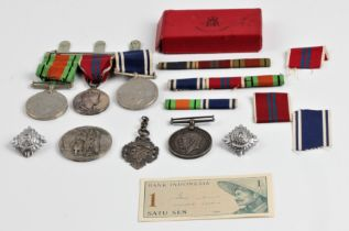 A collection of medals, a trio including 'FOR EXEMPLARY POLICE SERVICE', 'CROWNED 2ND JUNE 1953
