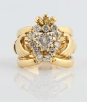 A hallmarked 18ct yellow gold diamond set Claddagh ring, set with a central heart cut diamond,