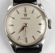 A lady's Omega wristwatch, the silver-tone dial having hourly baton markers, on black leather strap.