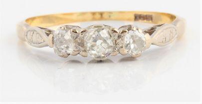 A three stone diamond ring, set with three graduated old cut diamonds, total diamond weight