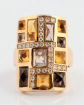An 18ct yellow gold Rodney Rayner multi-gemstone ring, the rectangular head set with a geometric