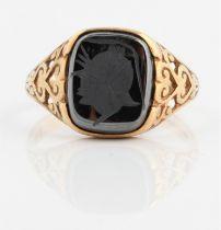 A hallmarked 9ct yellow gold hematite intaglio ring, ring size Q½.
