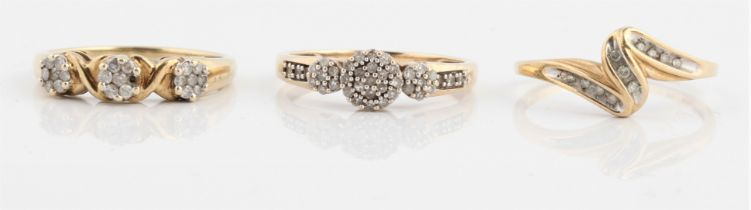 Three hallmarked 9ct yellow gold diamond rings, of differing design, ring sizes P.