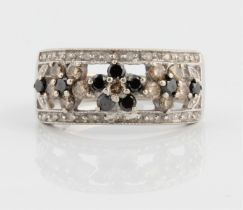A diamond set band ring, the open metalwork flower design set with colourless, black and yellow