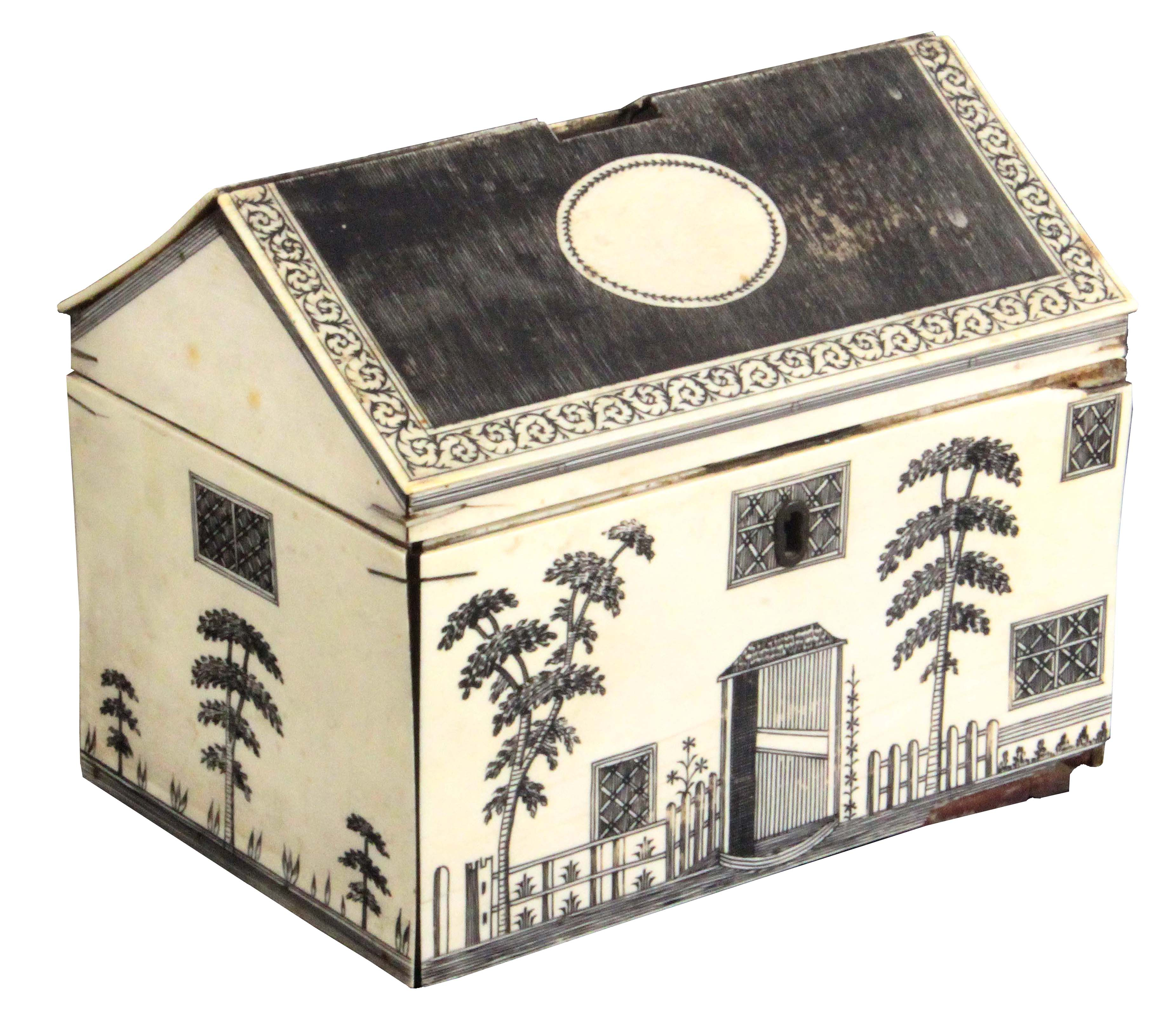 A rare early 19th Century Anglo-Indian ivory veneered sewing box in the form of a house, the pitched