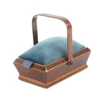 A rosewood Tunbridge ware pannier form pin cushion, the canted sides with geometric mosaic border,