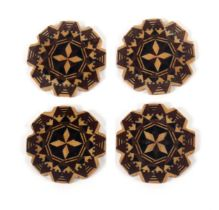 A scarce set of four Tunbridge ware thread winders, each in geometric stick ware and of circular