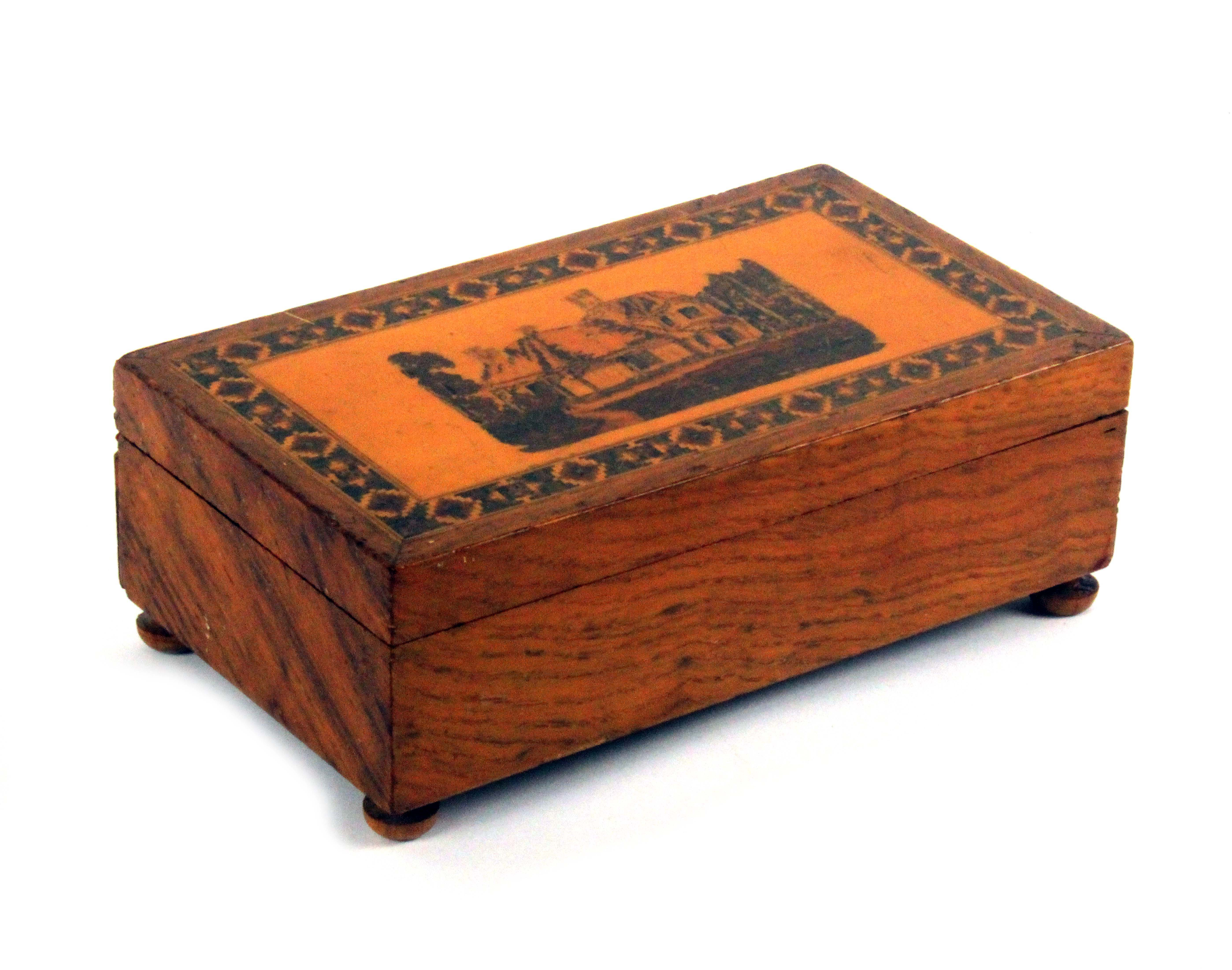 A late Tunbridge ware figured oak card box, of rectangular form, the lid with an inset mosaic