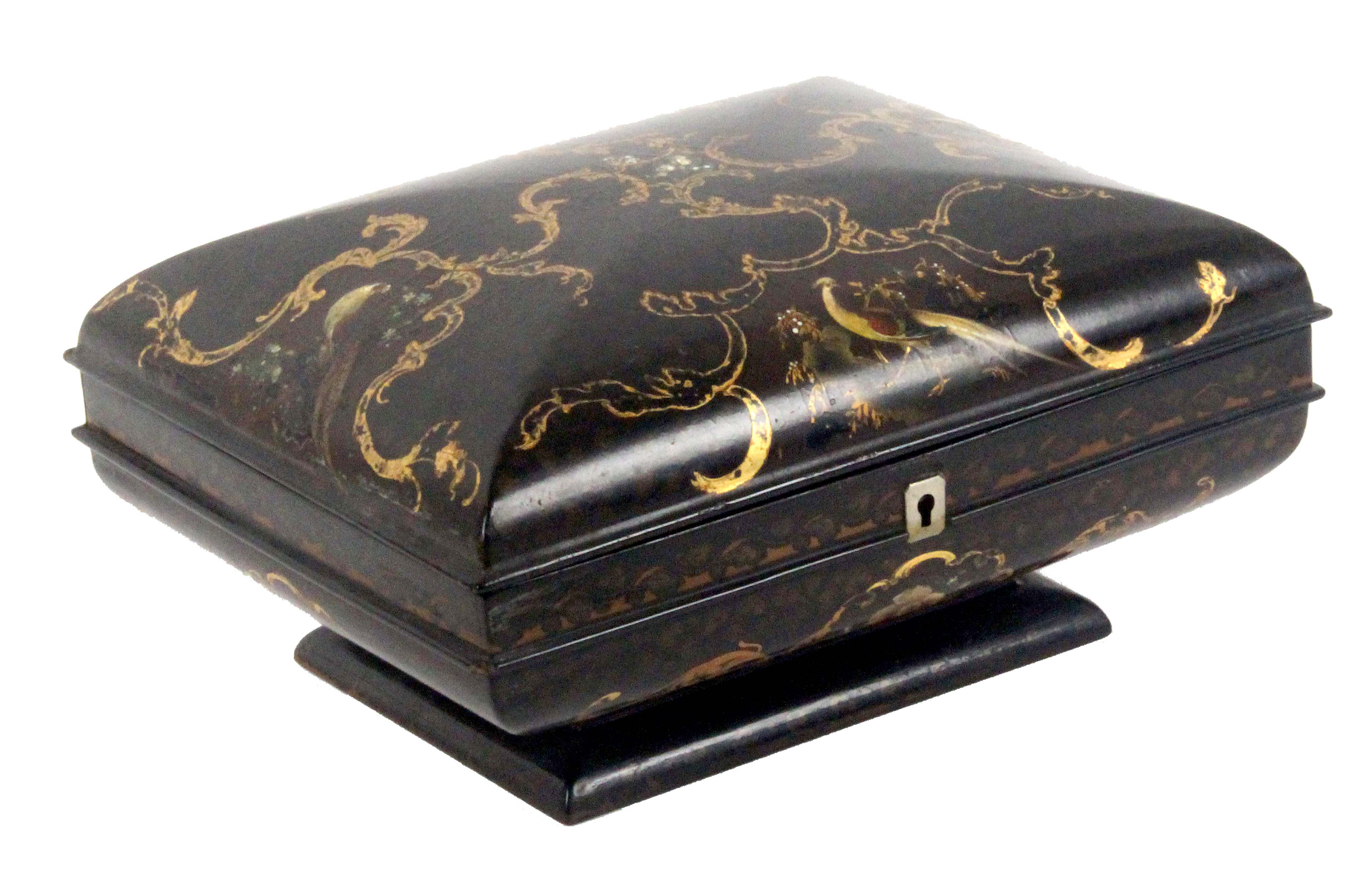 An unusual format and particularly well fitted papier mâché sewing box, circa 1830, the box of
