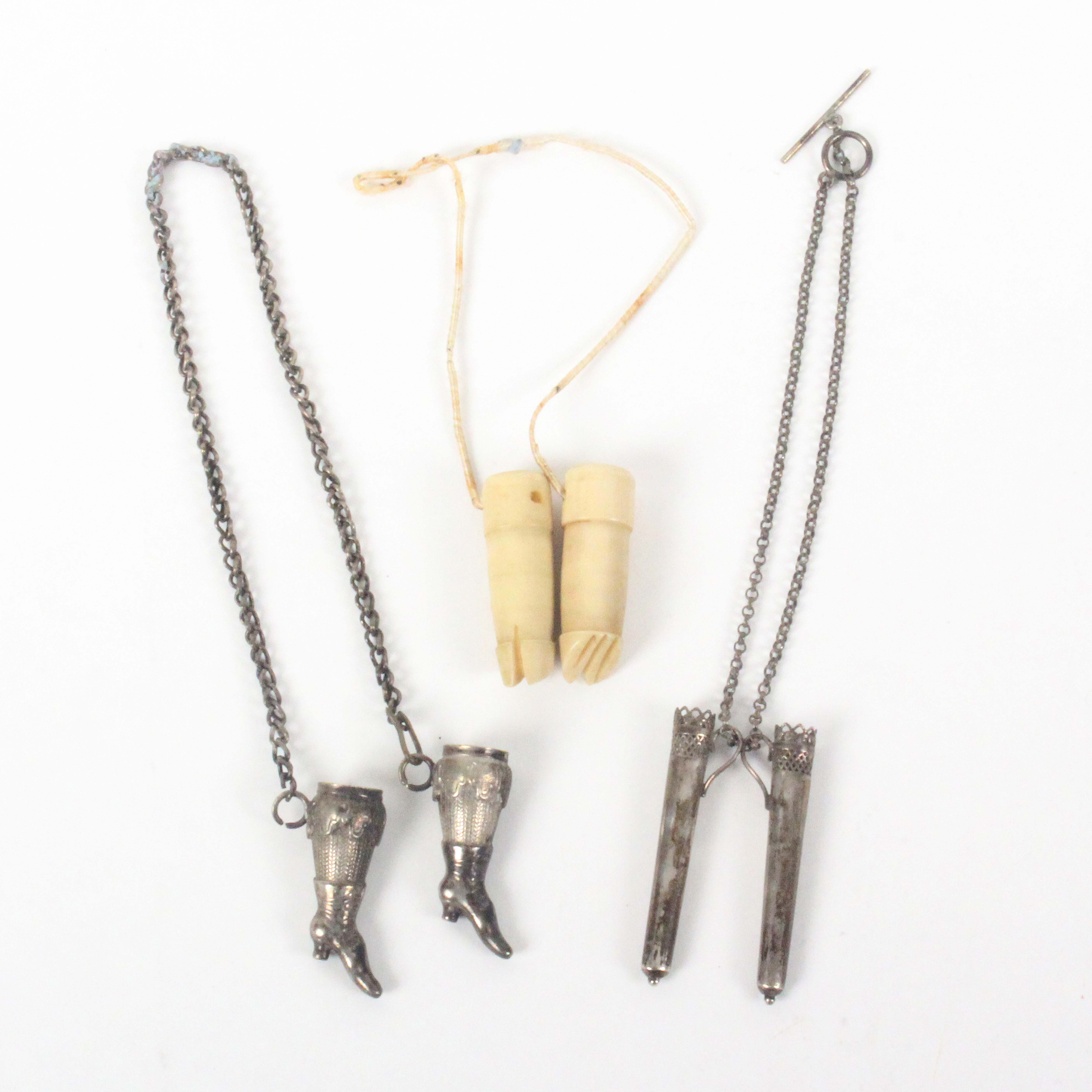 Three pairs of knitting needle protectors, comprising a silver pair in the form of lady's boots