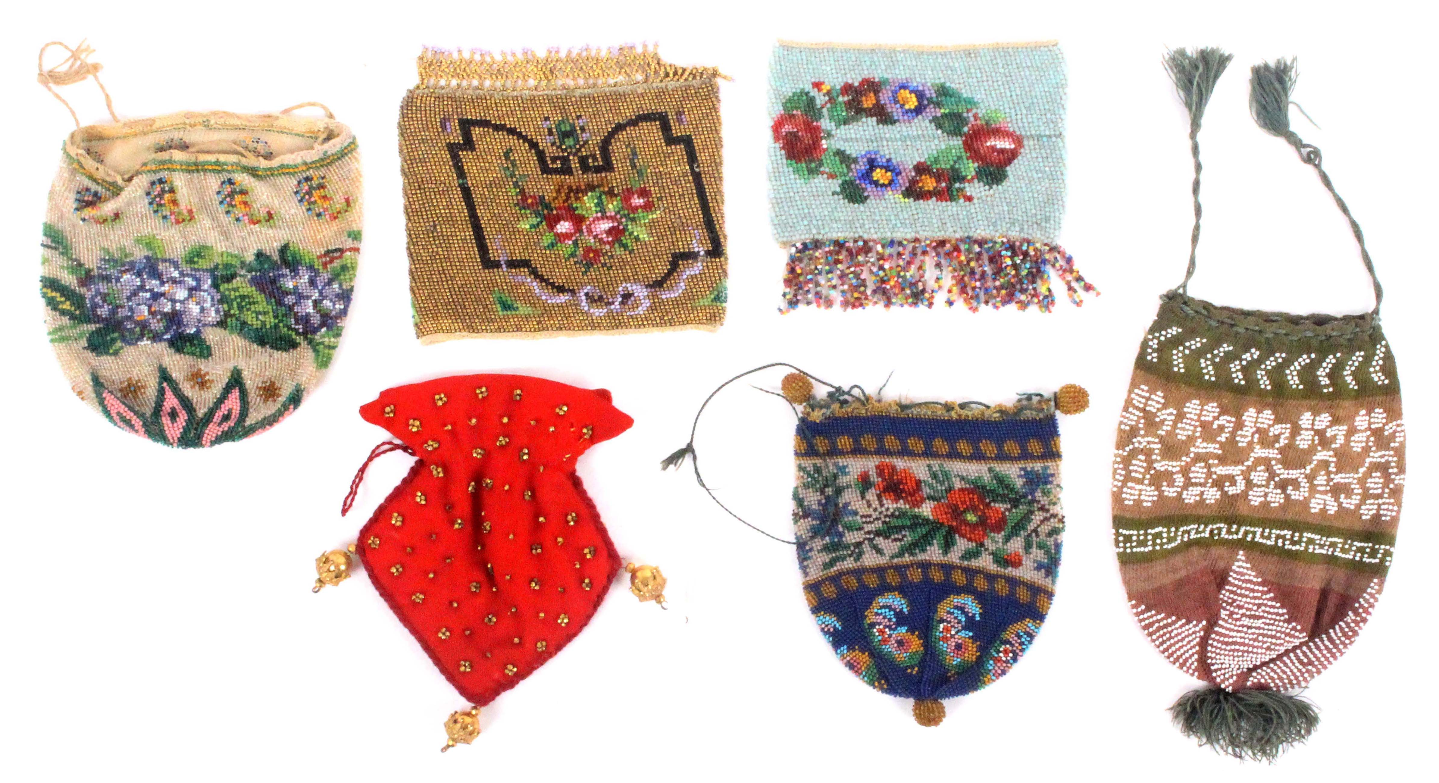 Six small 19th and 20th Century beadwork bags and purses, including two floral decorated draw string