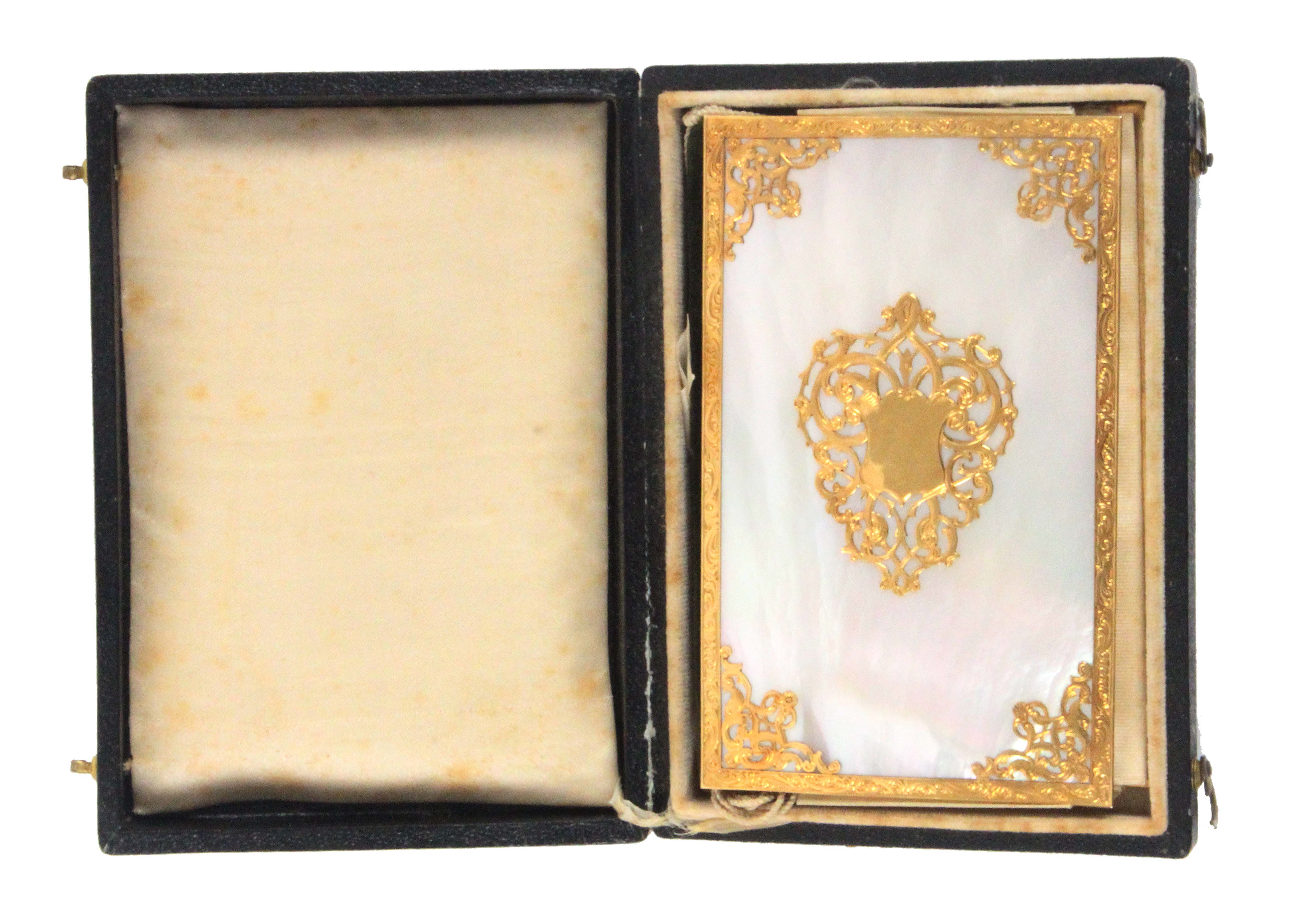 A fine gold mounted mother of pearl notelet/visiting case, complete with outer box, the book form