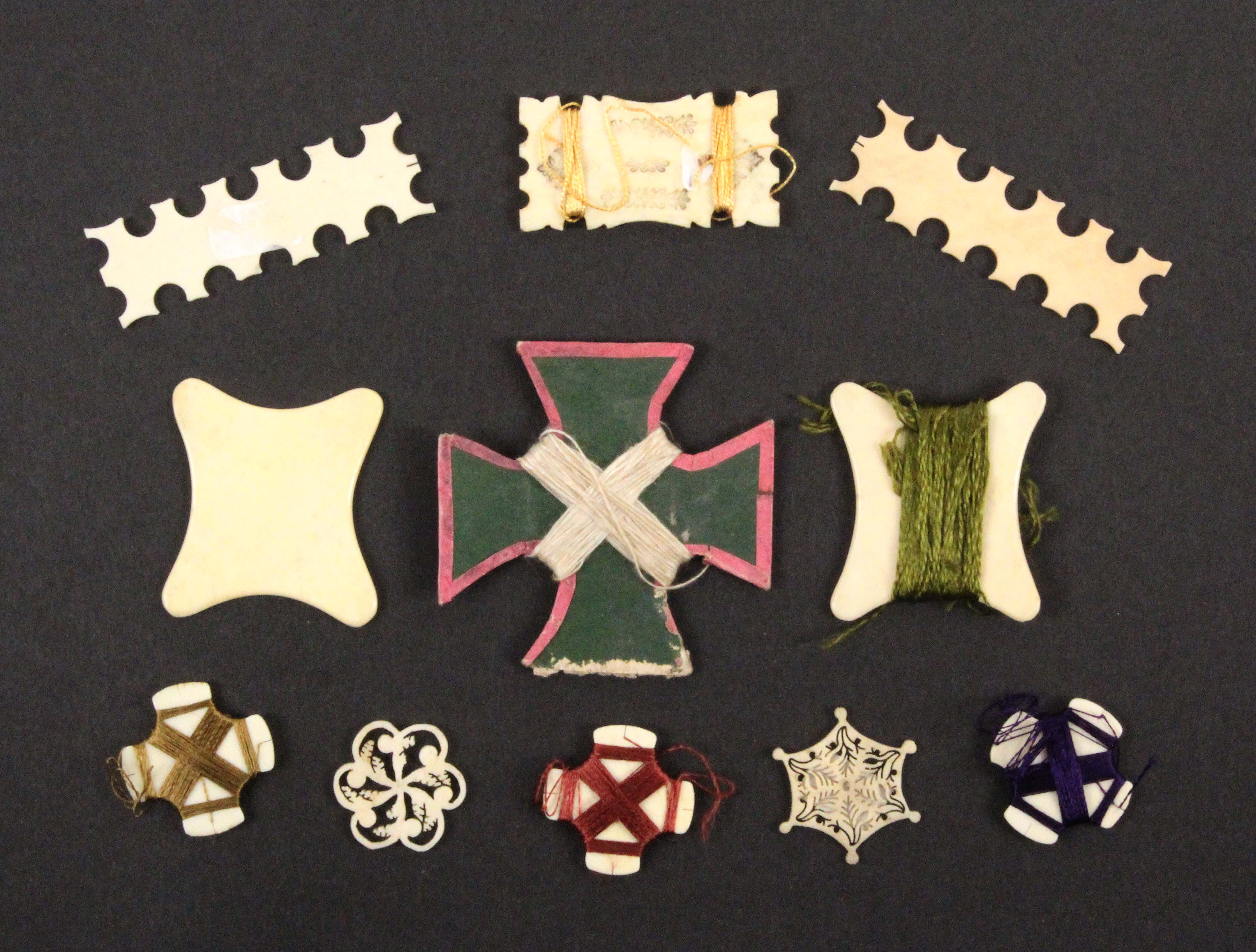 Eleven thread winders, 19th Century, comprising a cross form card example, s.d., and ten bone and