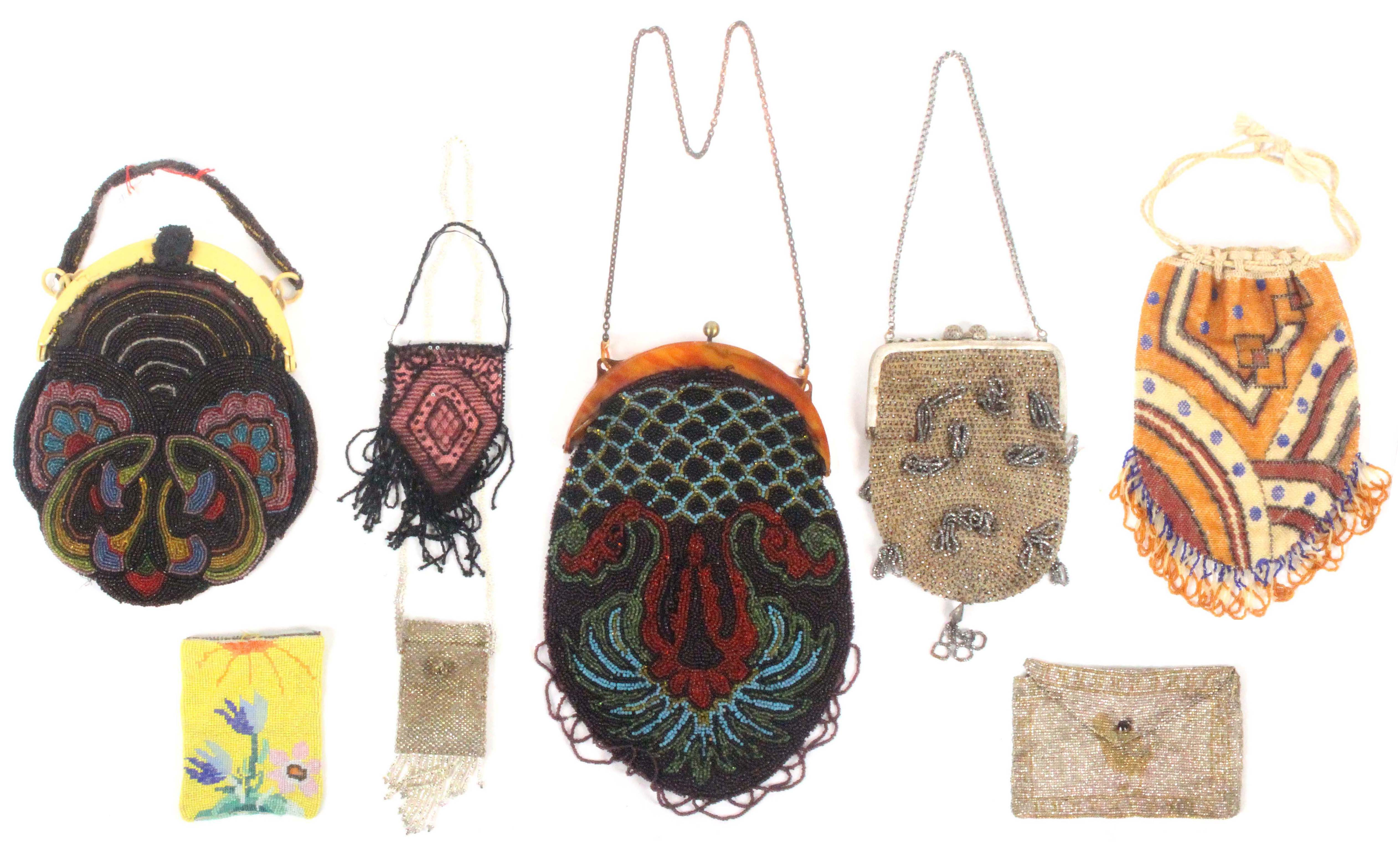 Eight early 20th Century beadwork bags and purses, comprising two geometric examples with