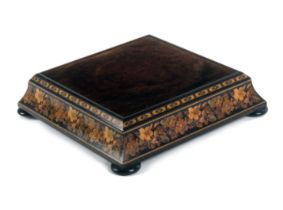 An unusual Tunbridge ware stand by Thomas Barton, of square form raised on four rosewood bun feet,