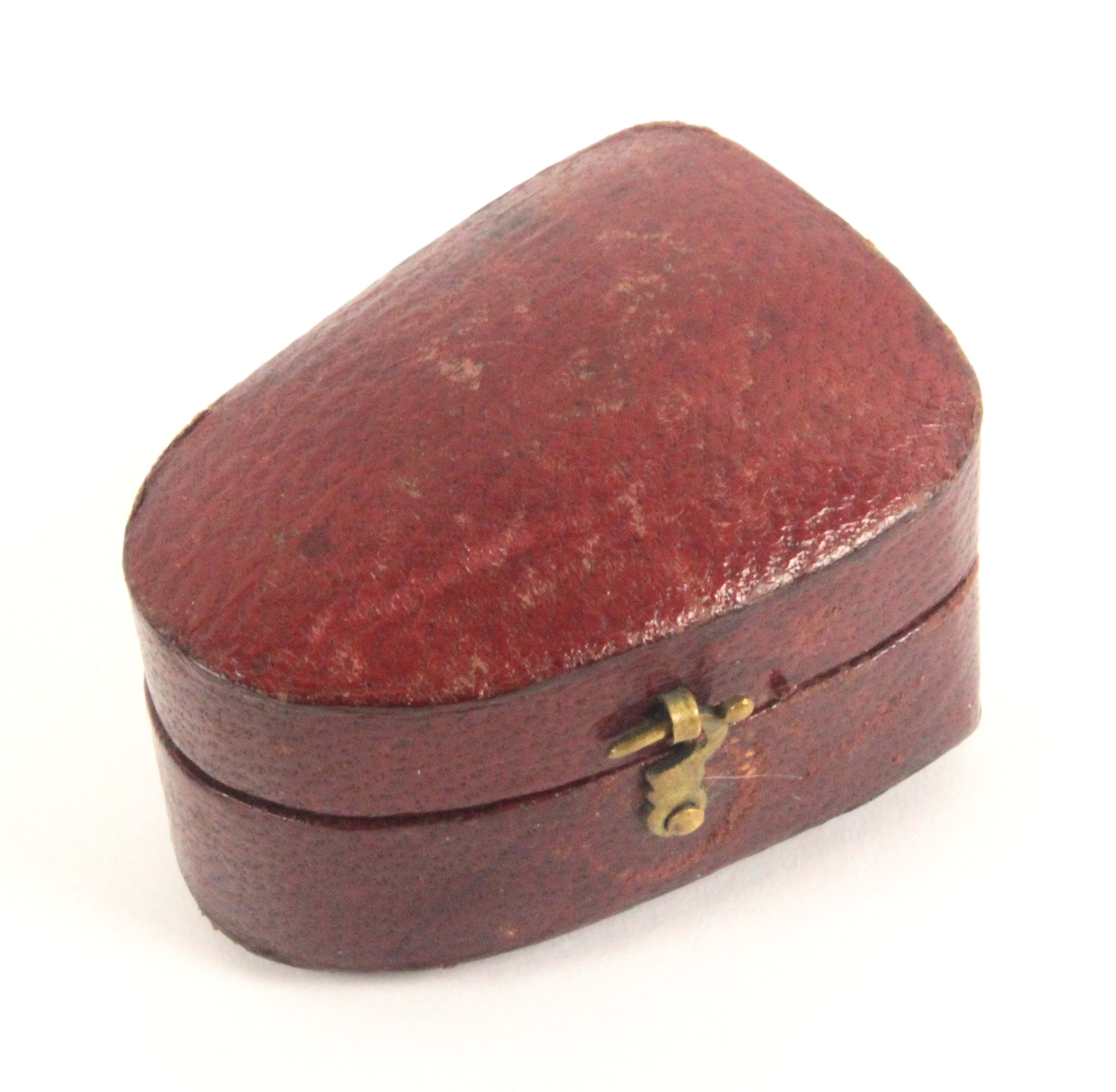 A Palais Royal thimble, with double gilt band and gold shield motif, in a red leather case, hinge - Image 2 of 2