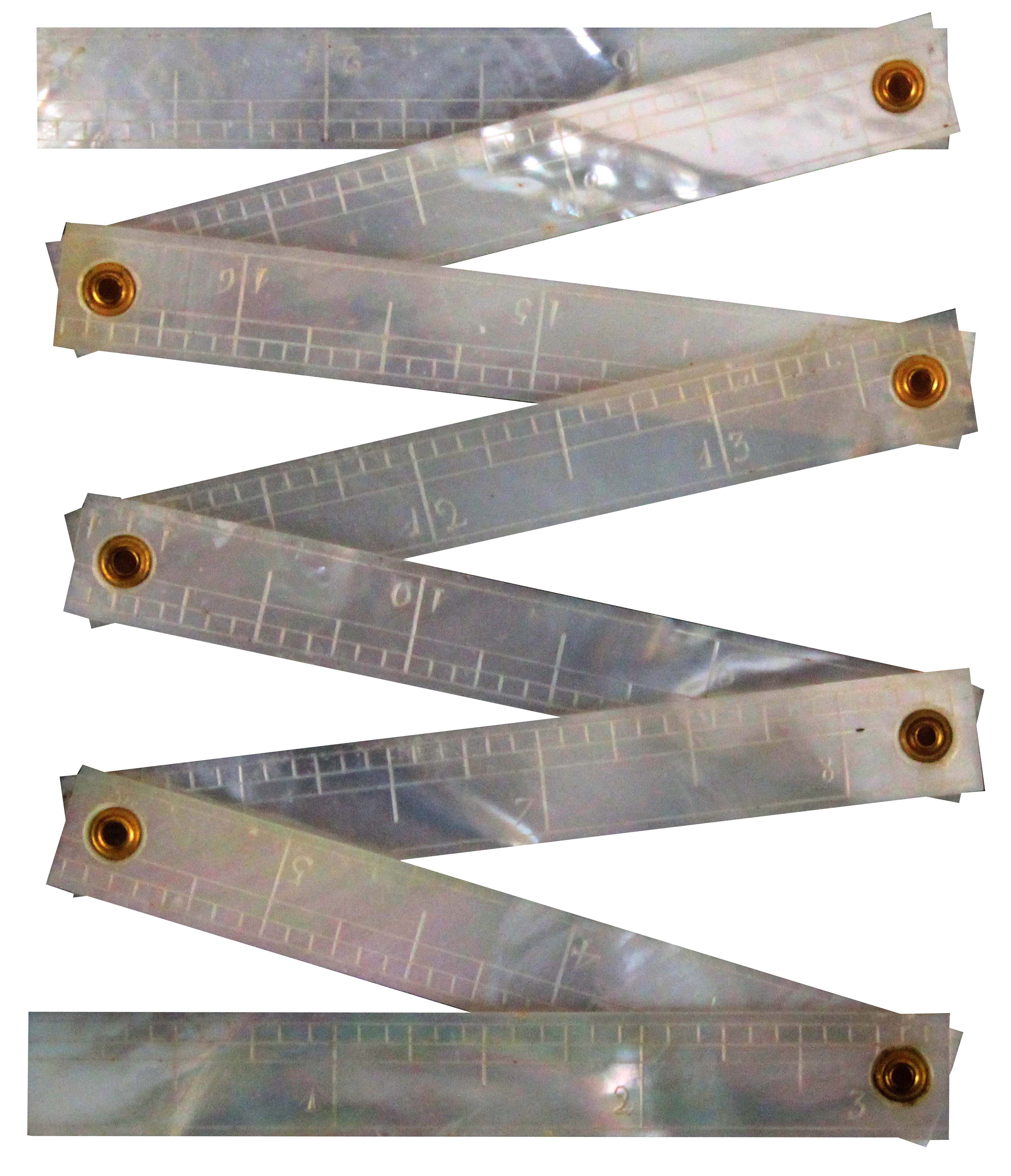 A rare mother of pearl 22ins folding ruler, probably Palais Royal, in eight hinged sections, one