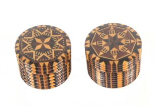 A near pair of rib turned rosewood stick ware cylinder boxes, each with screw-off stick ware lid,