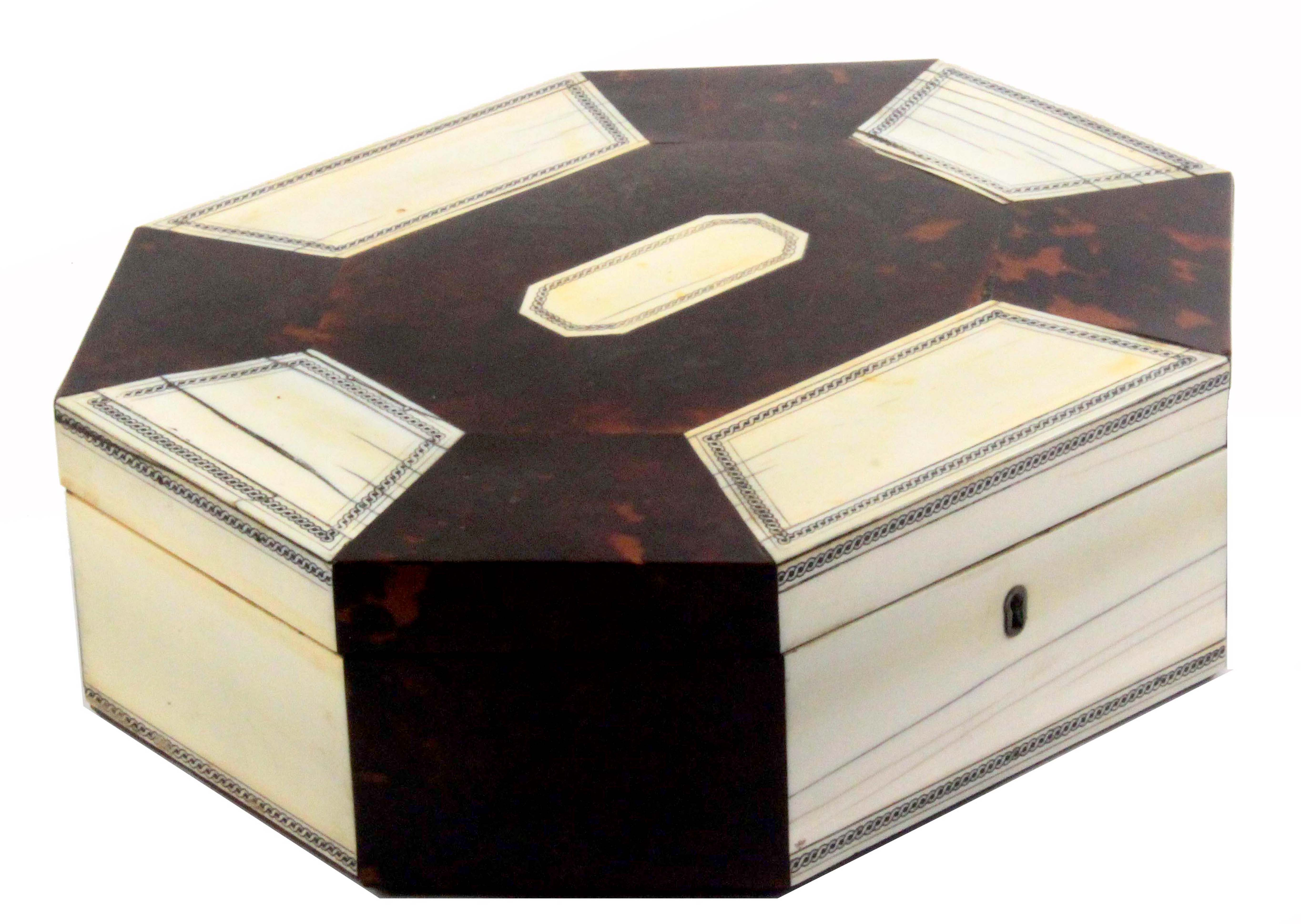 An early 19th Century Anglo-Indian sandal wood, ivory and tortoiseshell sewing box of octagonal