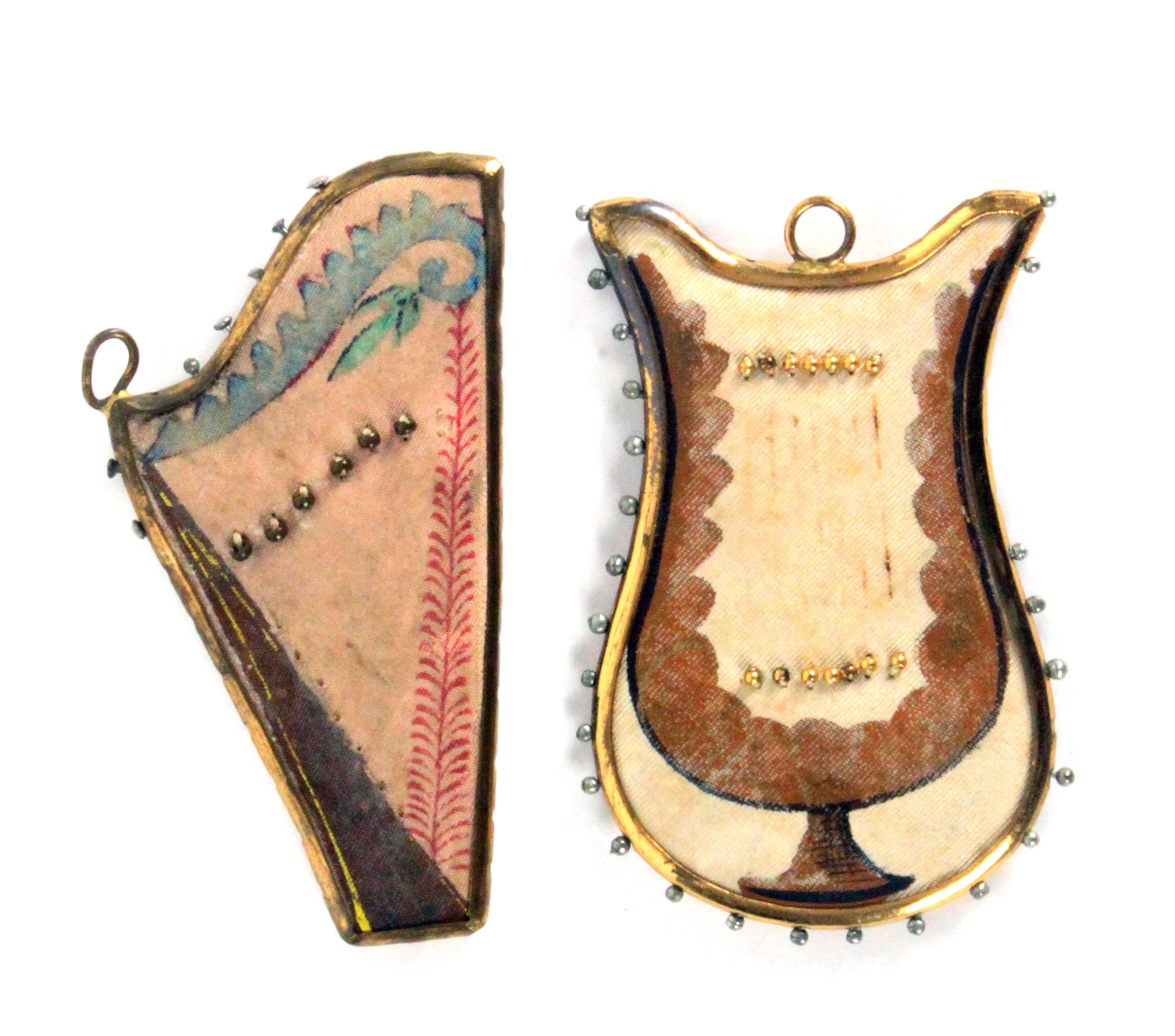 Two scarce metal frame early 19th Century pin retainers modelled as a harp and a lyre, each with