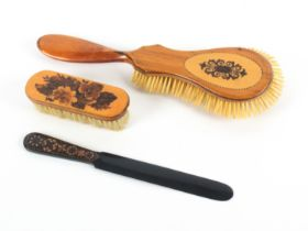 Tunbridge ware - three pieces, comprising a satinwood guitar shaped brush with a geometric mosaic