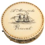 A rare early 19th Century ivory disc form pin cushion, one side engraved with a paddle steamer and