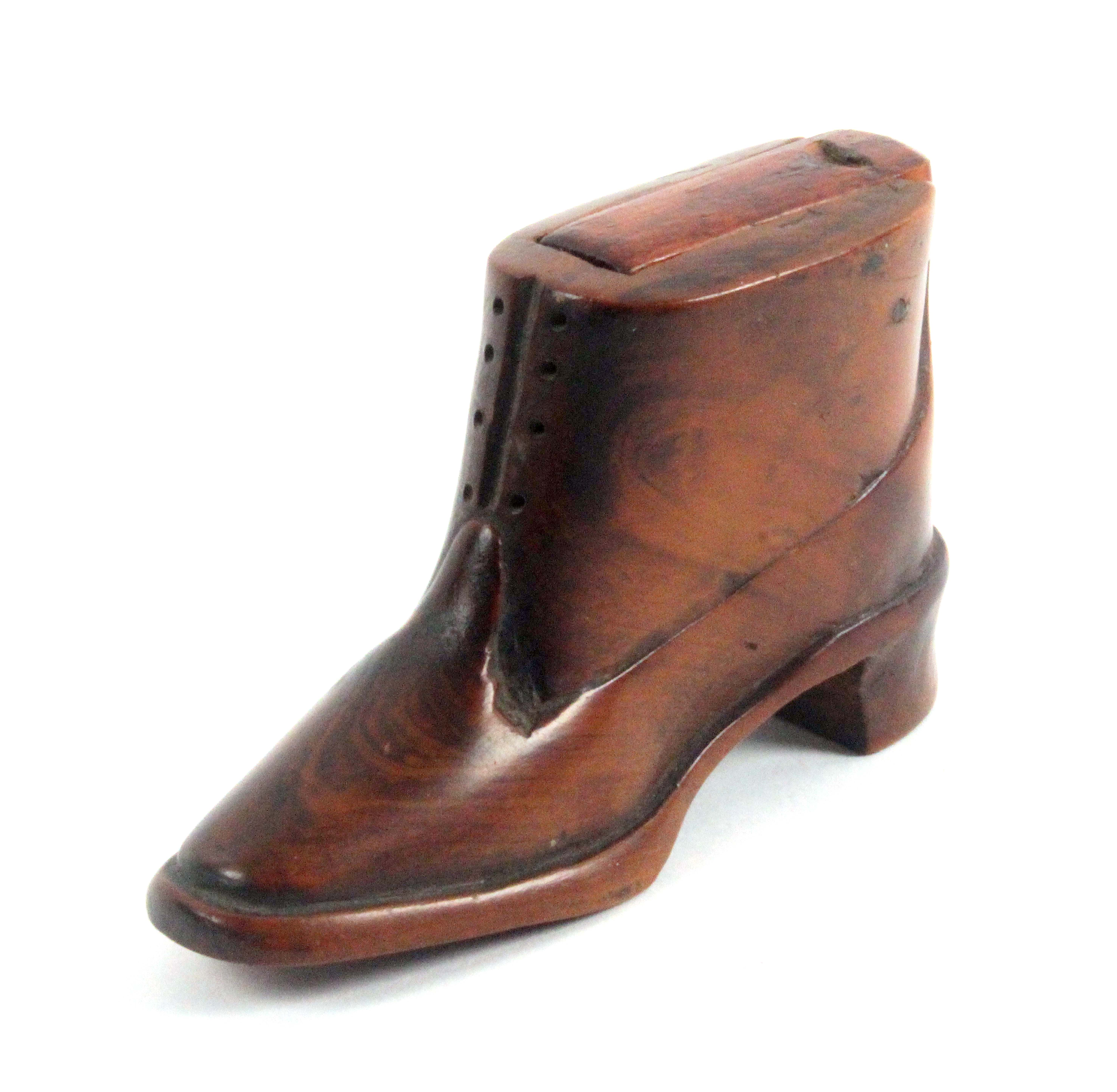 An unusual Boer War P.O.W. shoe form snuff box, in cedar wood with carved details, rounded toe,