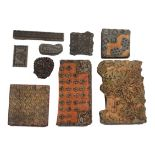 A collection of nine carved wood and other Macclesfield silk printing blocks, largest 41 x 23cms.