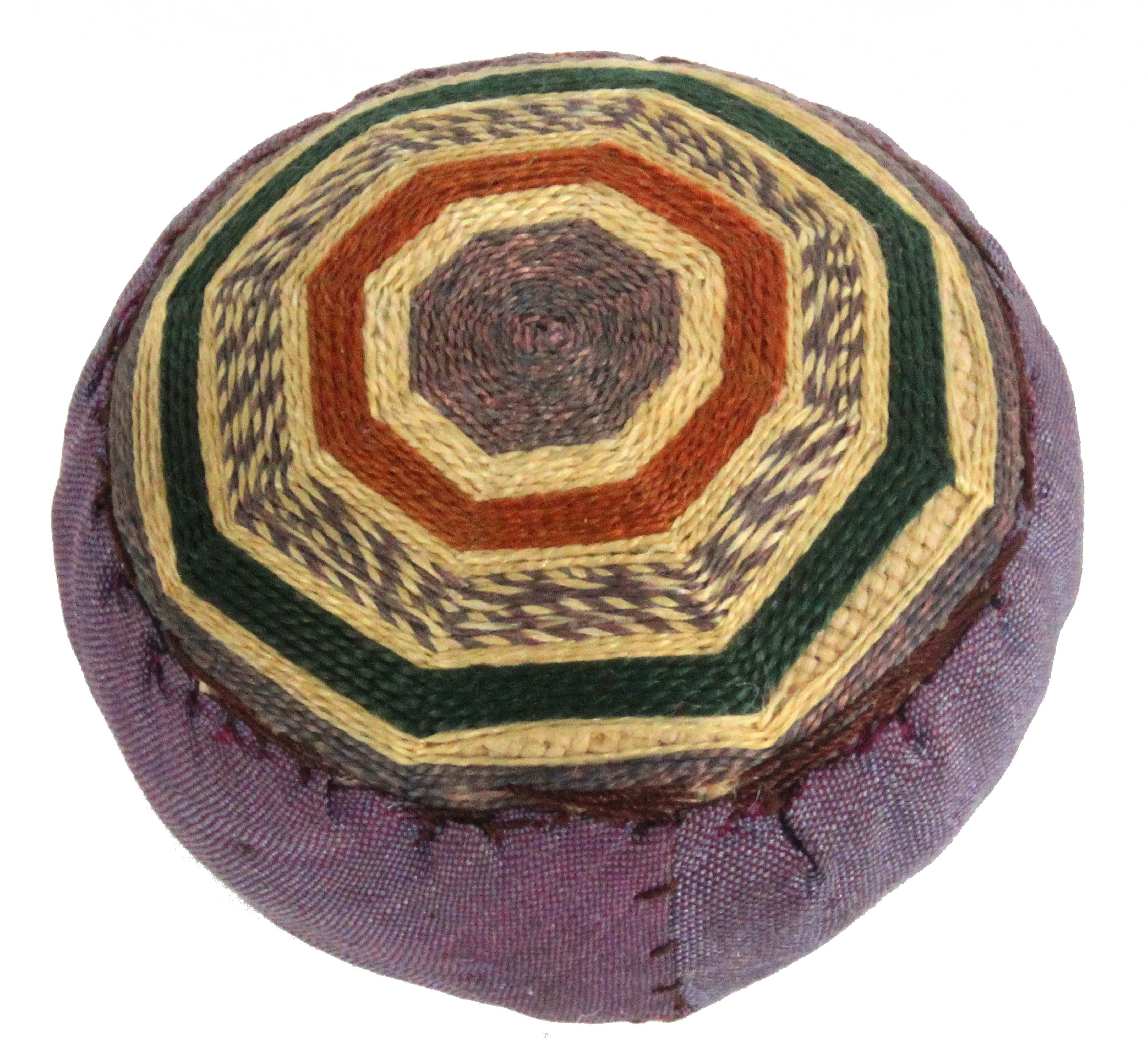 A late 18th Century coloured silk 'spiders web' pin ball, purple silk infill, 4cms.