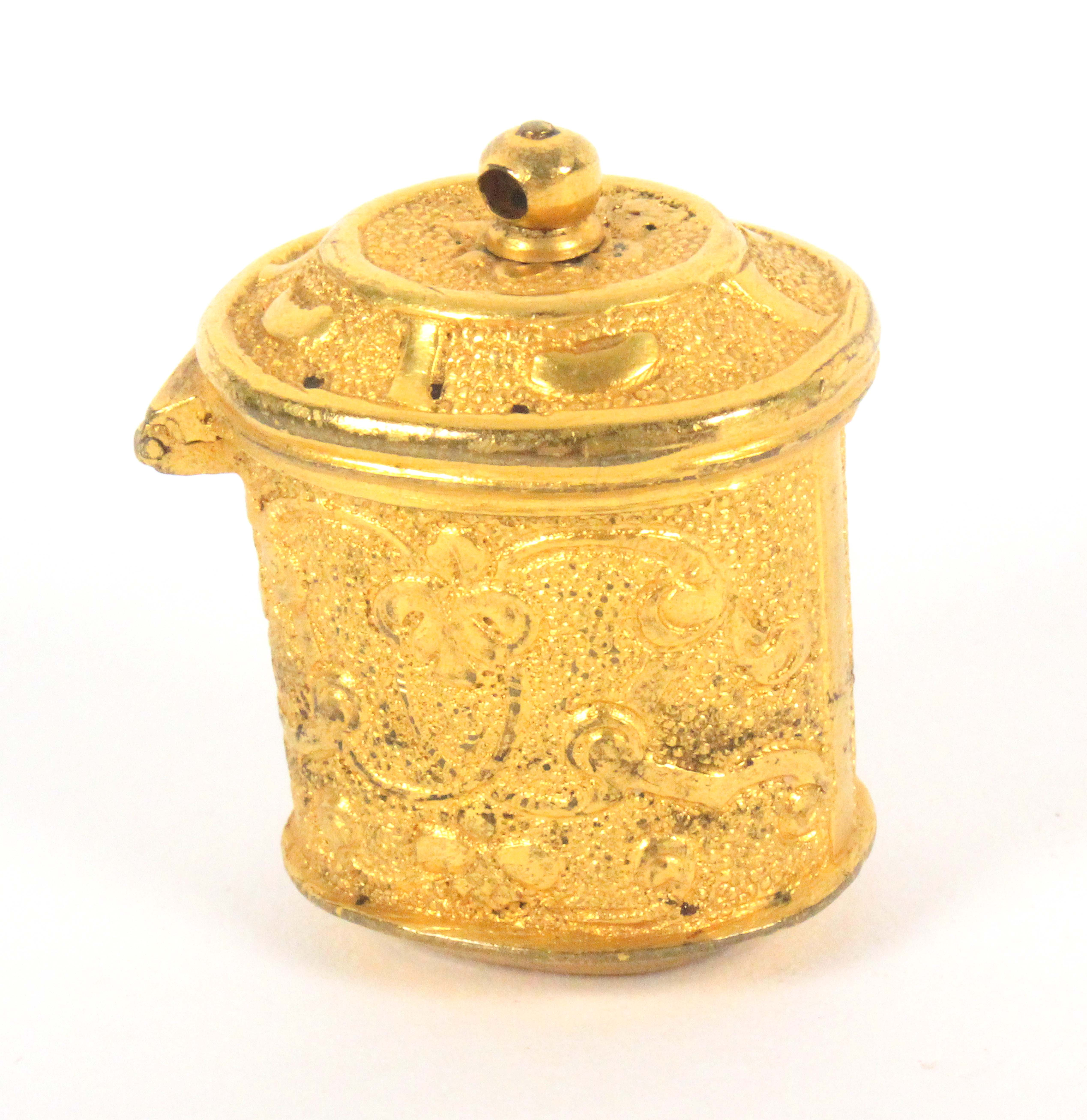 A late 18th Century gilded metal thimble case for a chatelaine, of oval form decorated with leaves