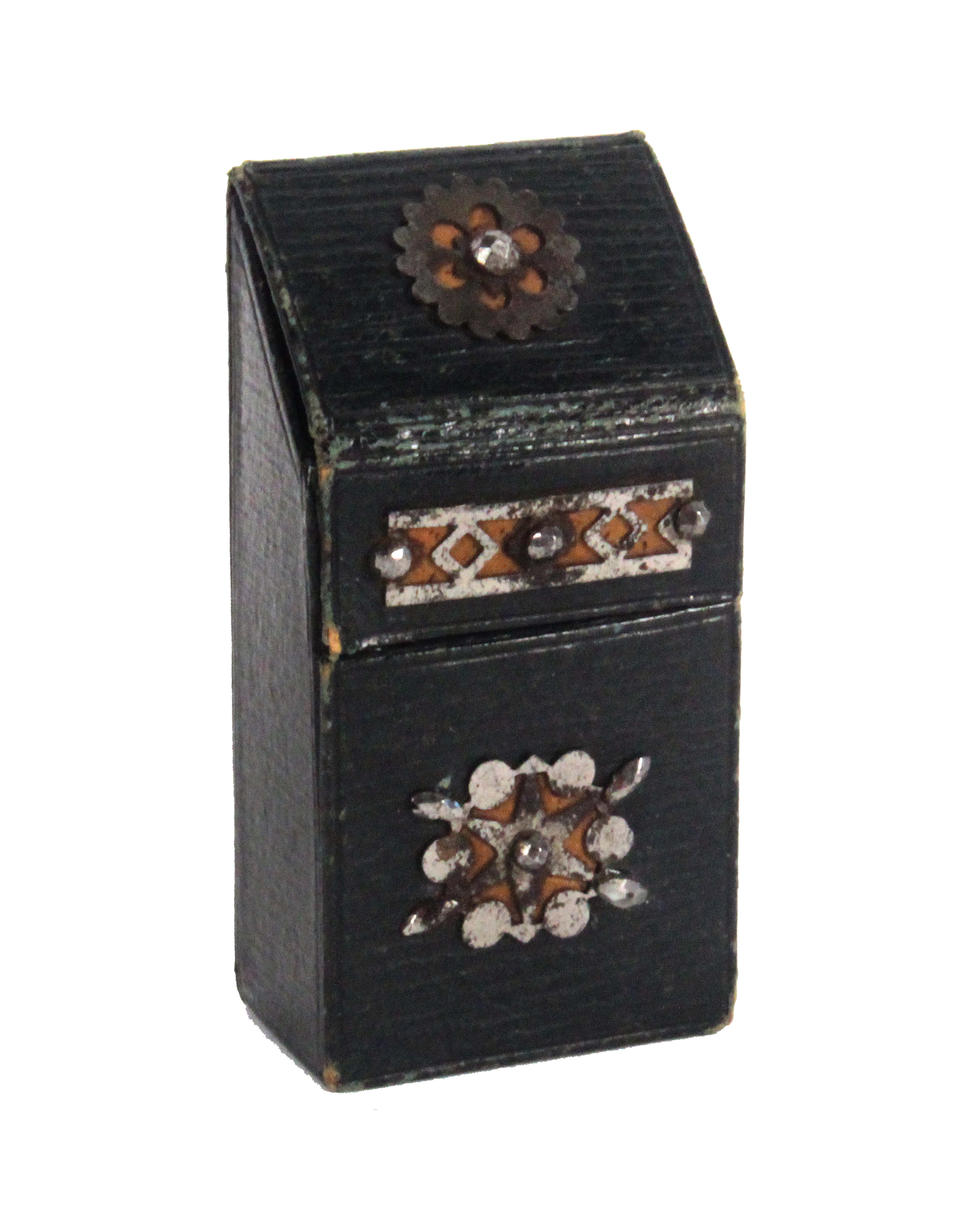 An unusual dark green leather slant top needle packet box, applied with part gilded cut steel
