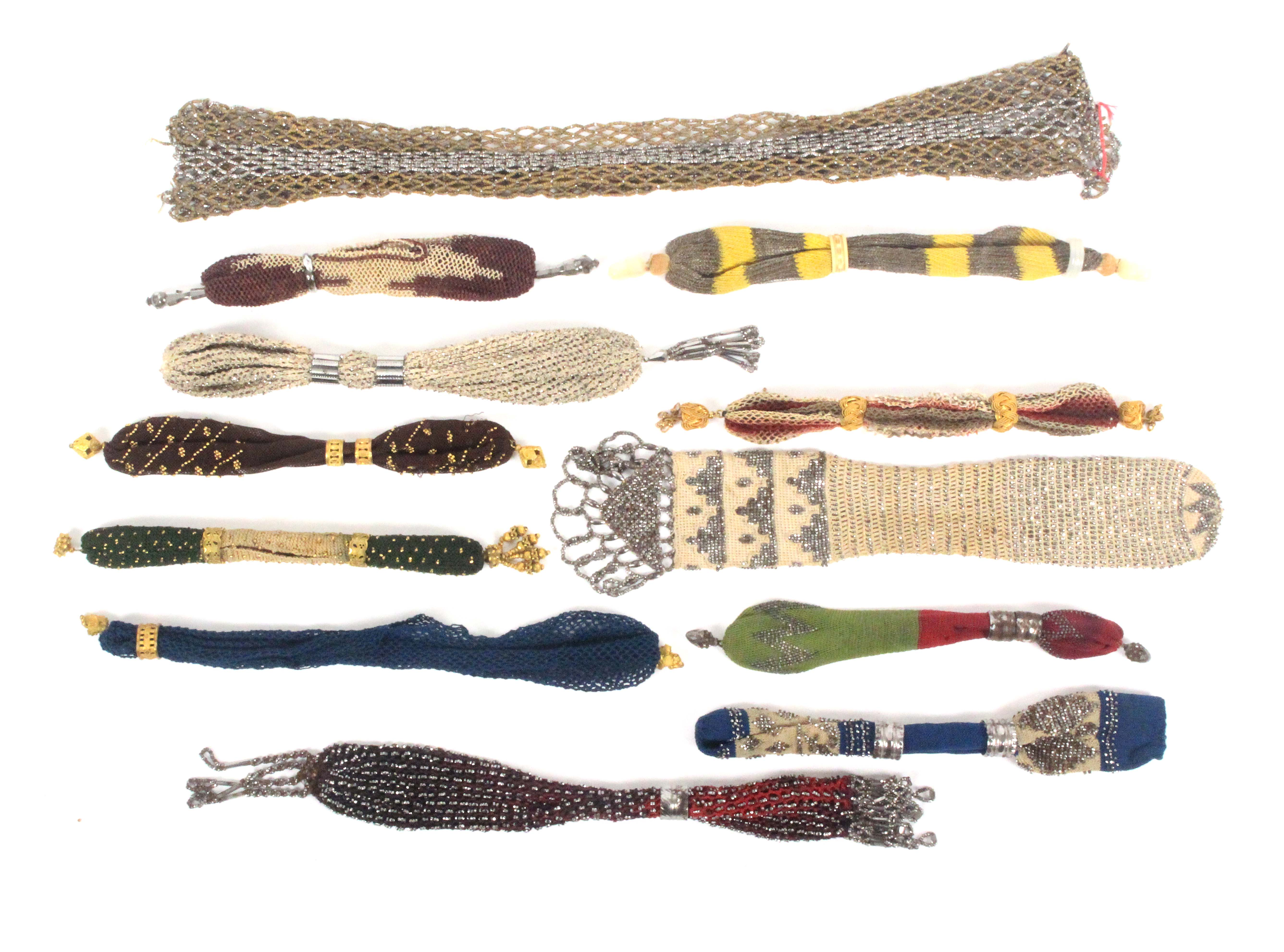 Twelve 19th Century misers purses, mostly of smaller format, largest in metal beadwork, 42cms.  (