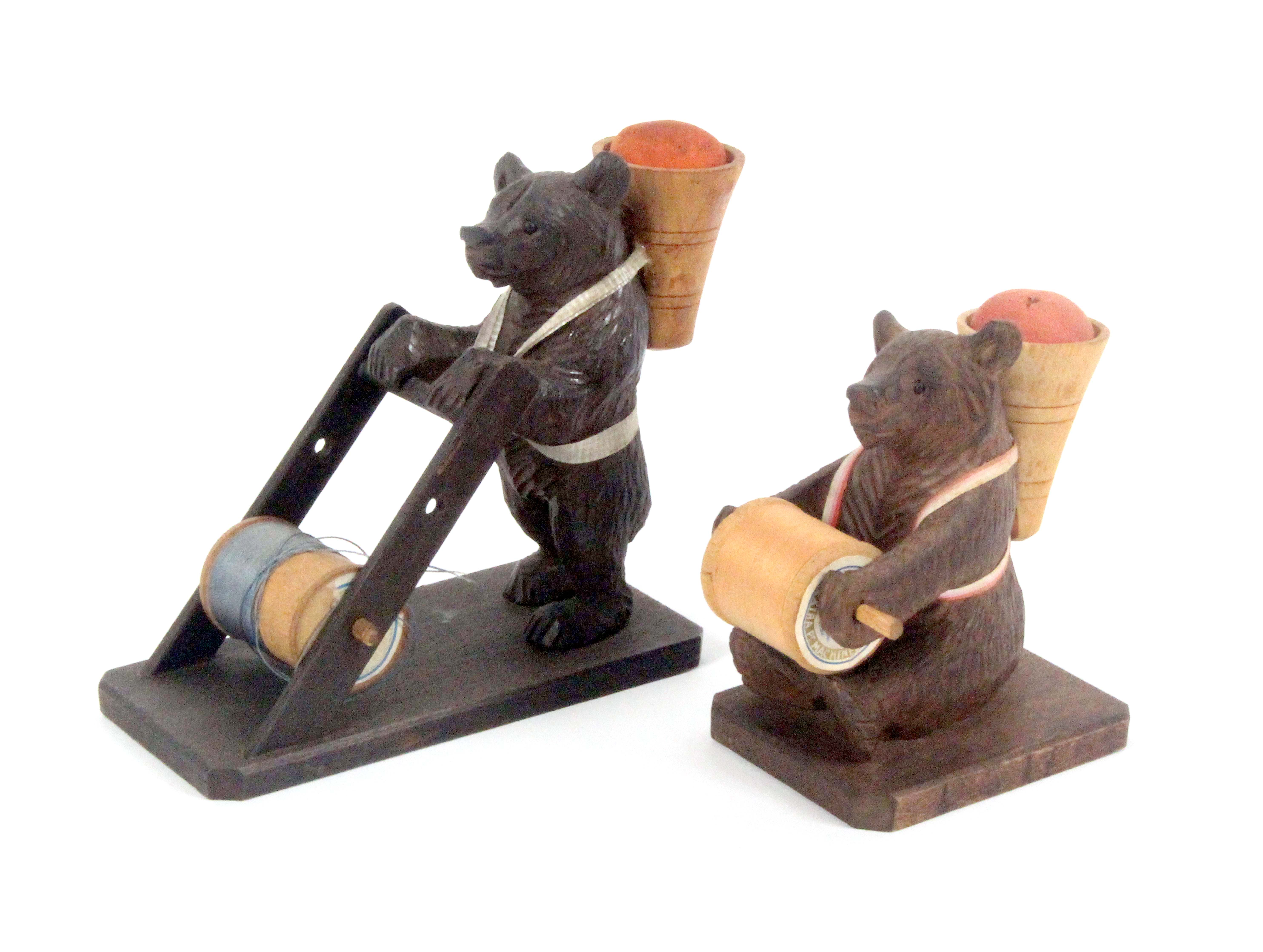 Two Black Forest carved wood bear form sewing companions, one as a standing bear with pannier form