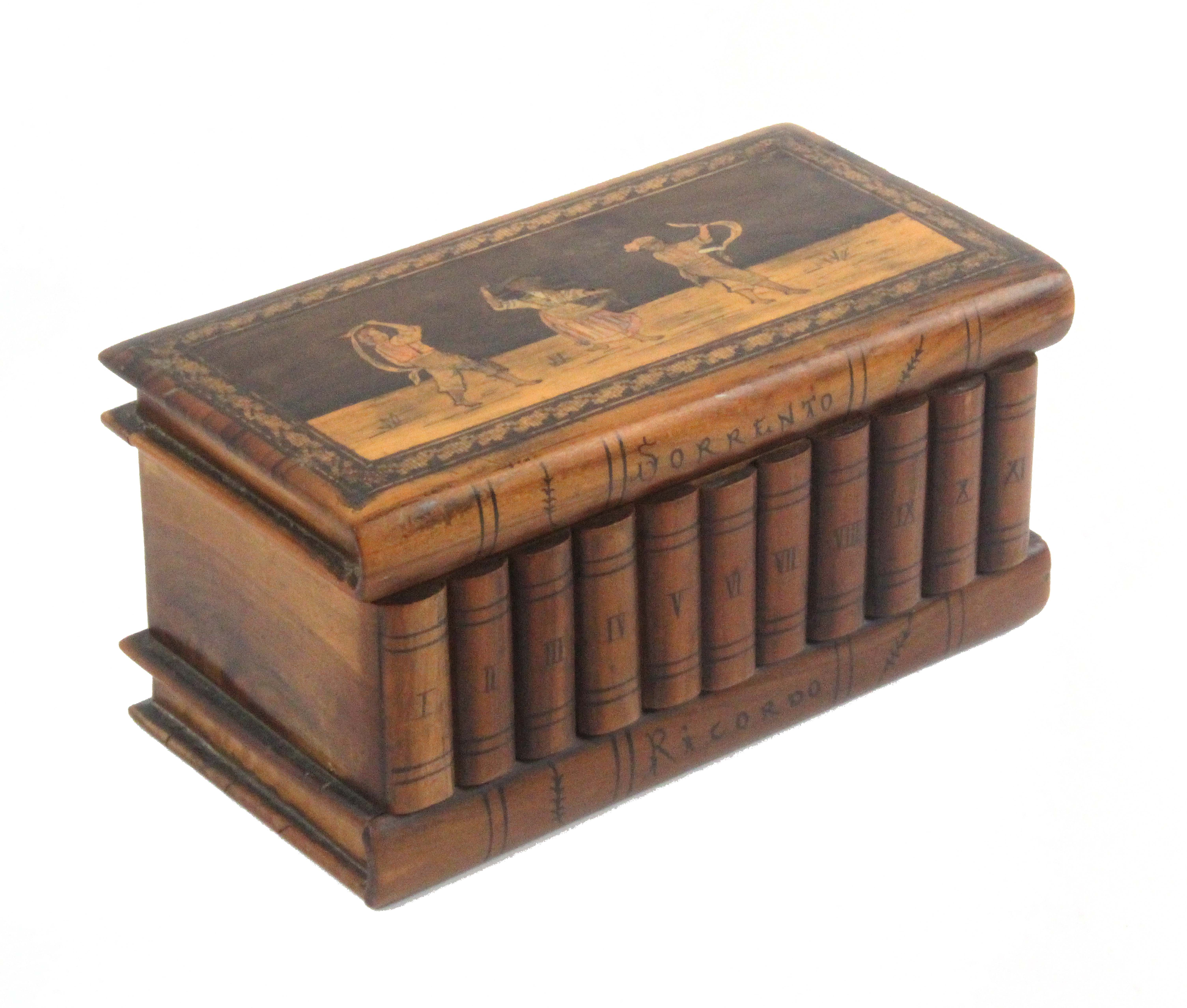A late 19th Century Sorrento ware 'book' box, the book form lid with a marquetry panel of three