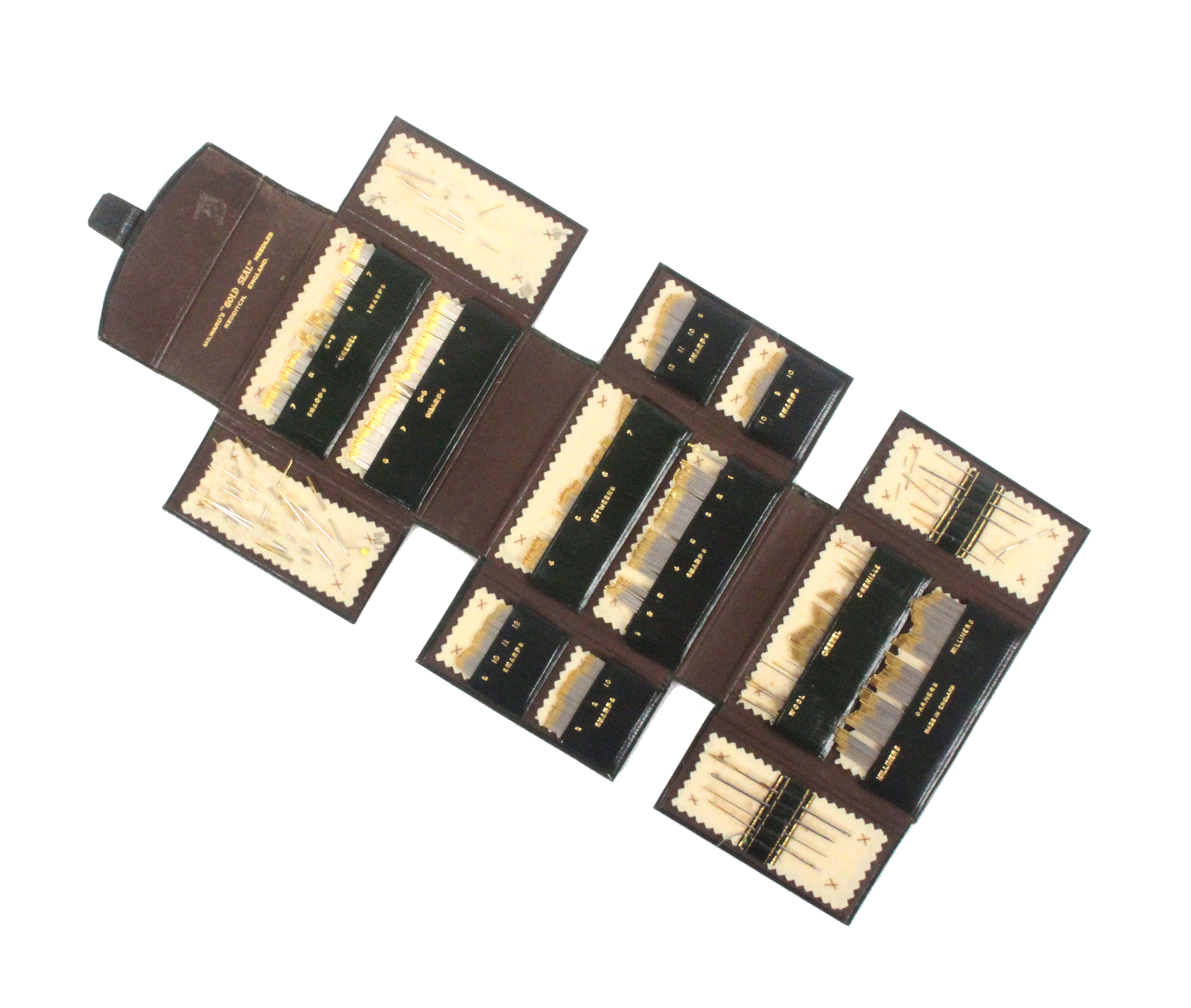A green leather concertina needle display, with gilt line decoration inscribed in gilt 'Millward's