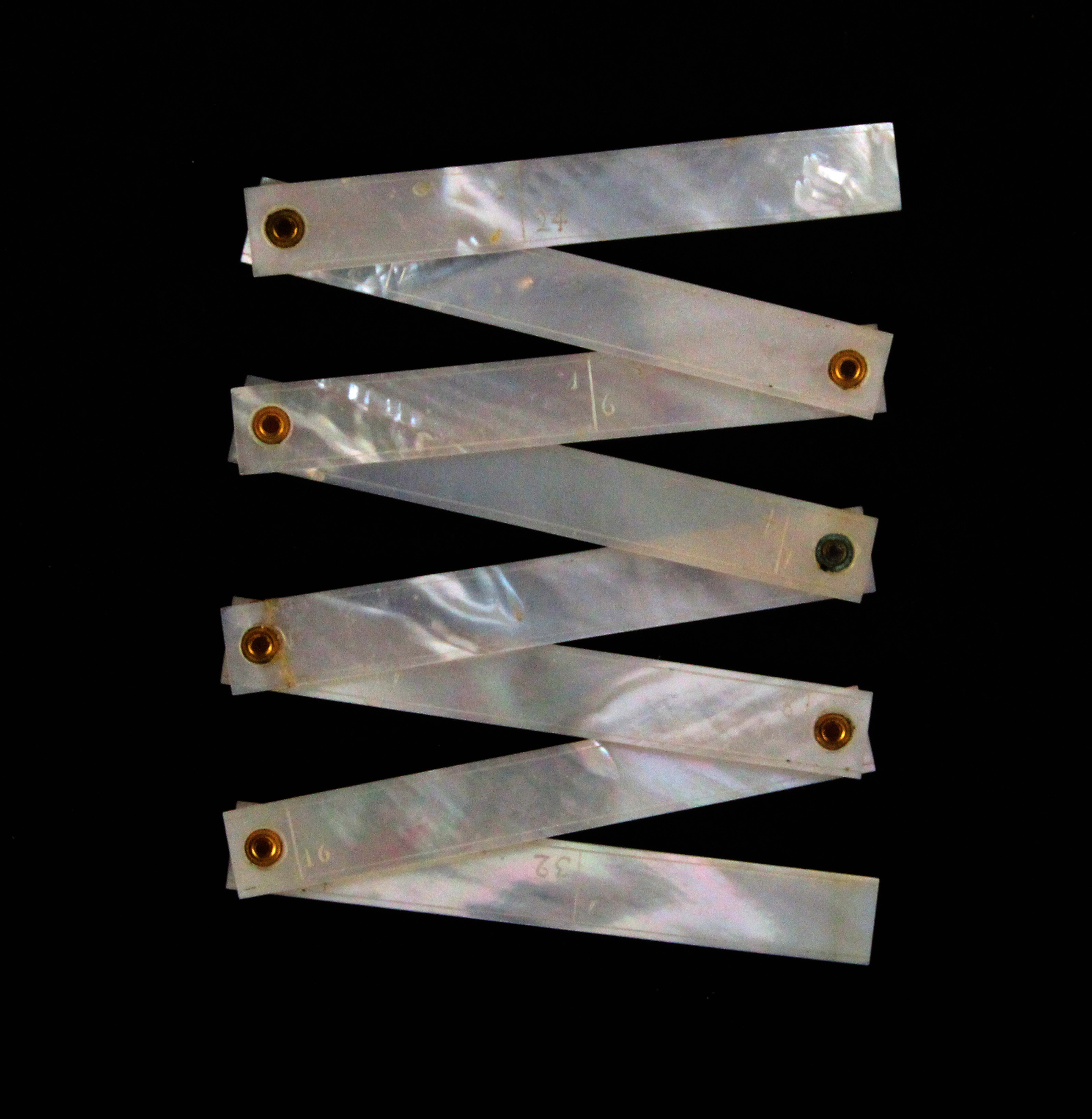 A rare mother of pearl 22ins folding ruler, probably Palais Royal, in eight hinged sections, one - Image 2 of 2