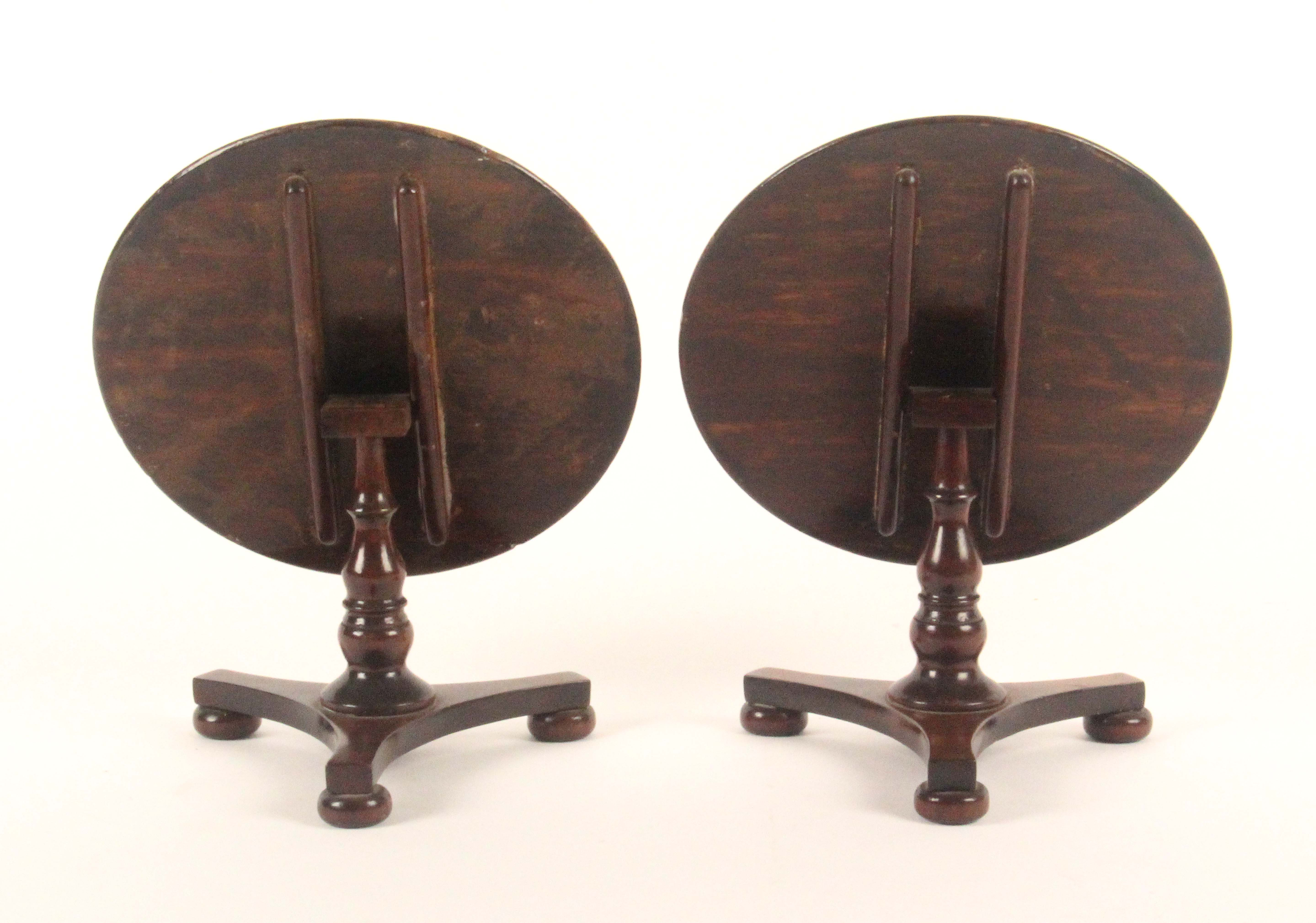 A pair of rosewood miniature circular tilt top tables, each with a tri-form base and three bun - Image 3 of 3
