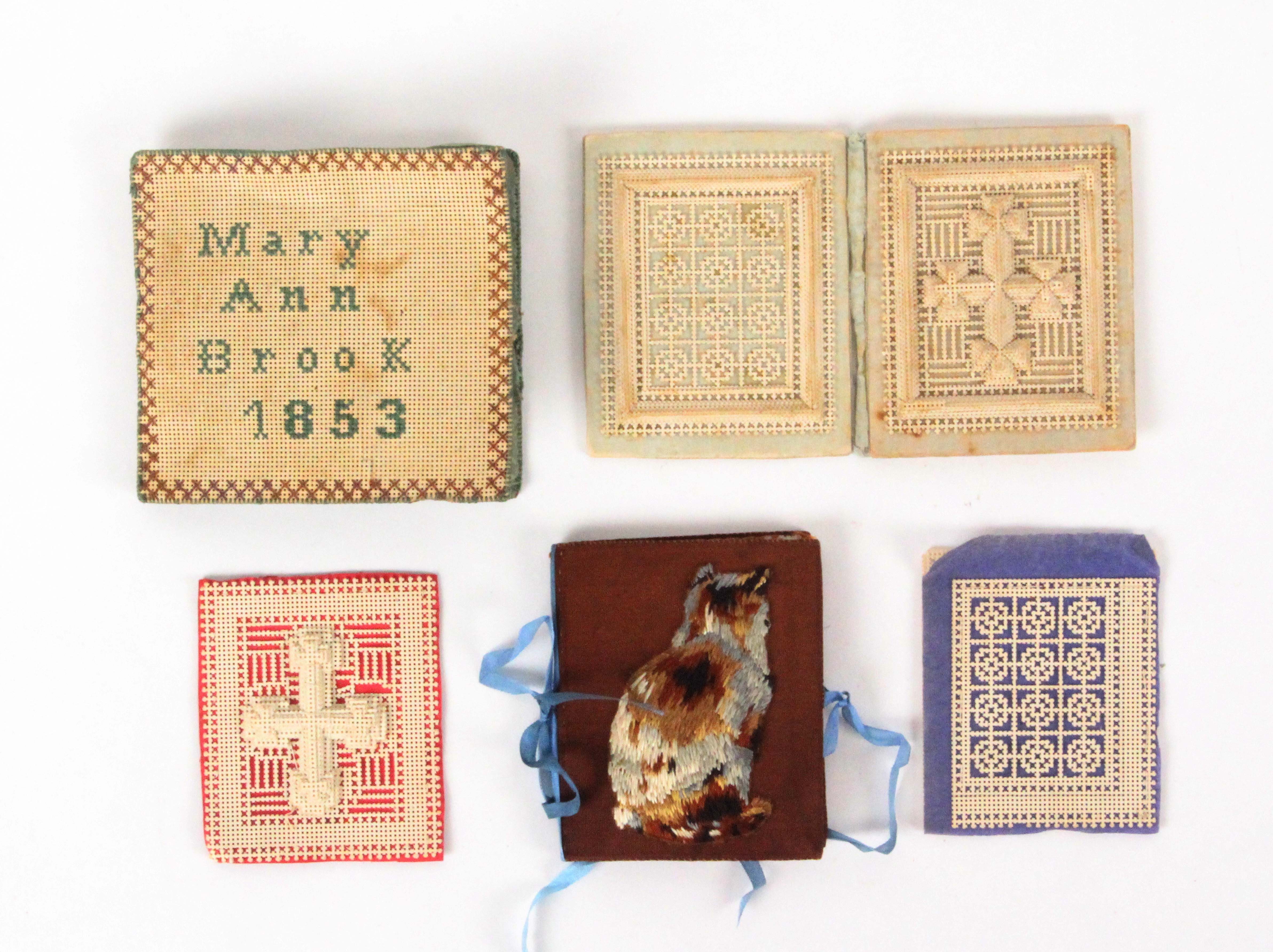 Three needle books and associated pieces, comprising a stacked card example, spine a little weak,