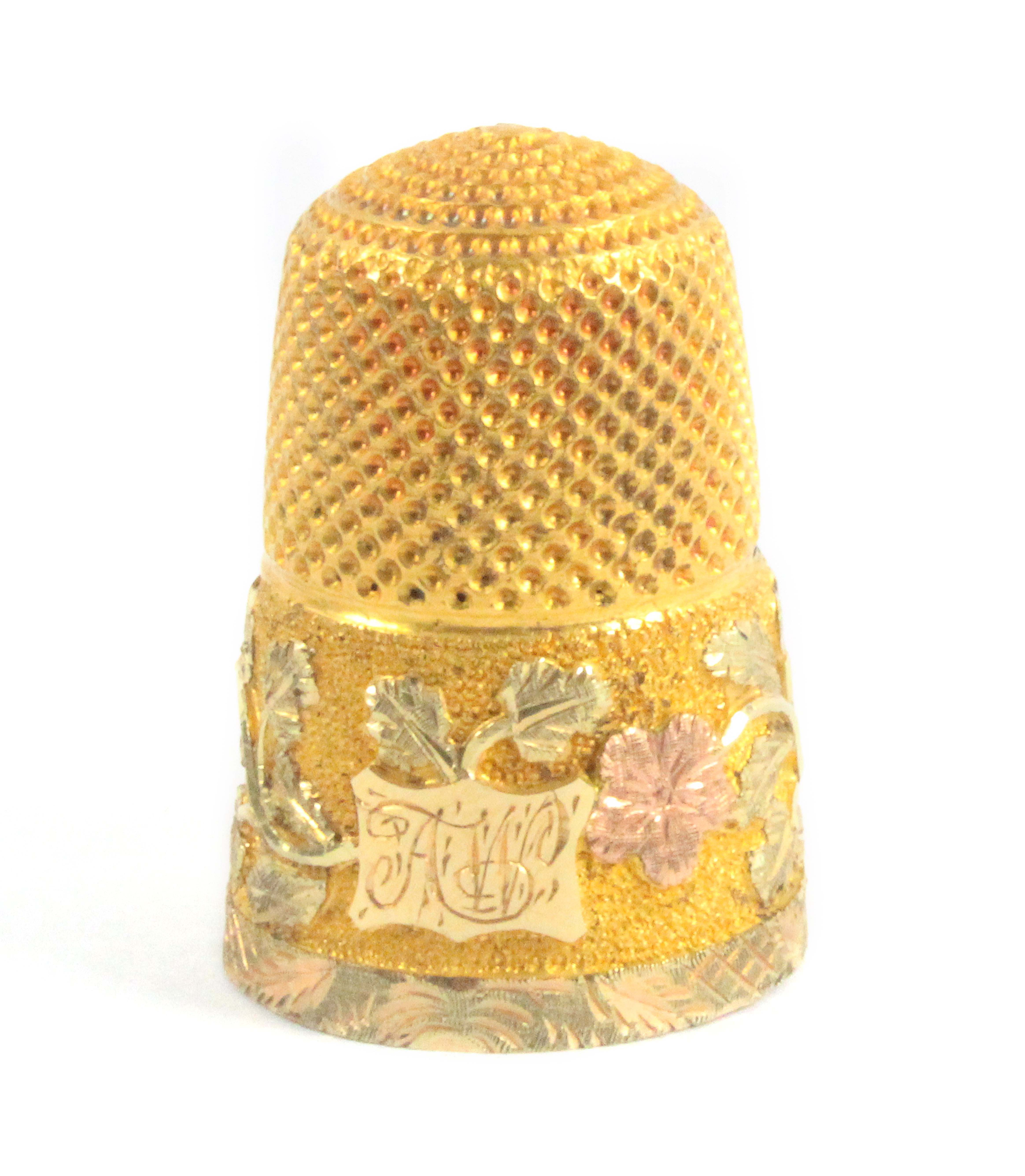 A Victorian three colour gold thimble, the frosted frieze with a cartouche initialled 'AW' and