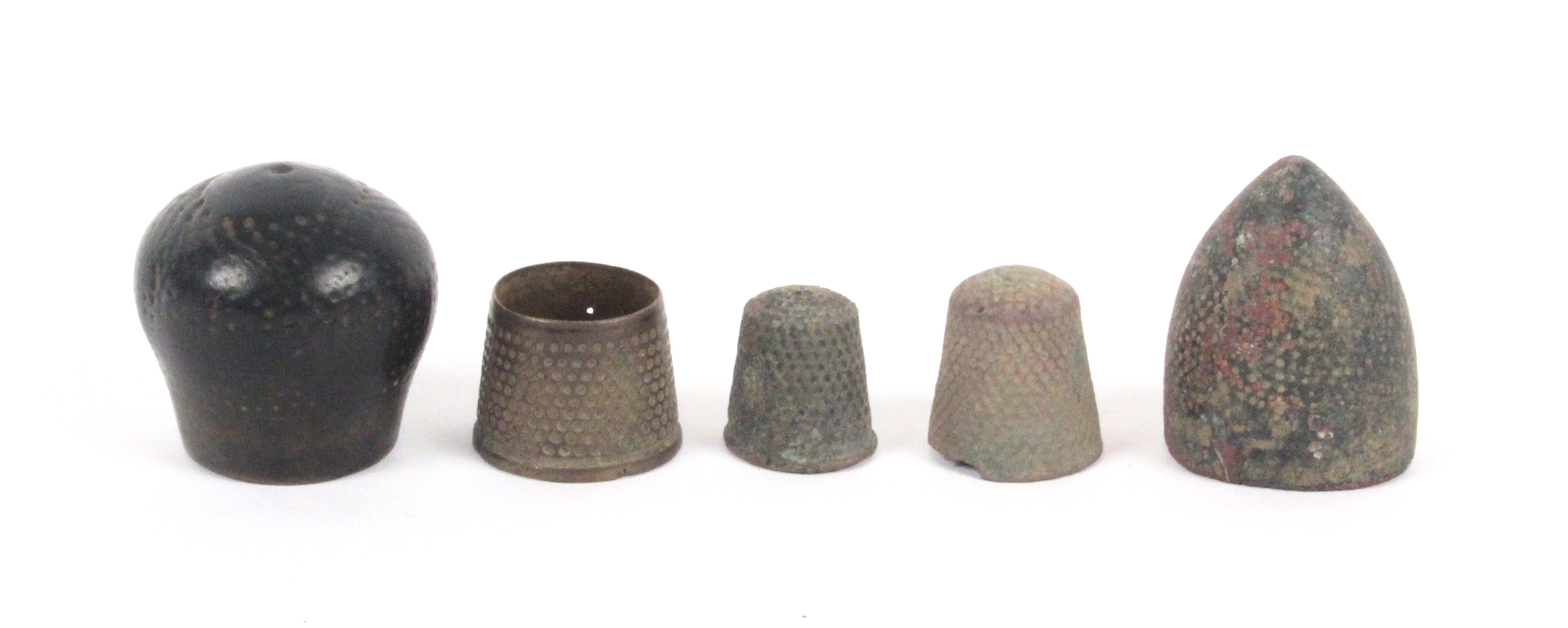 Five medieval excavated bronze and brass thimbles.  (5)