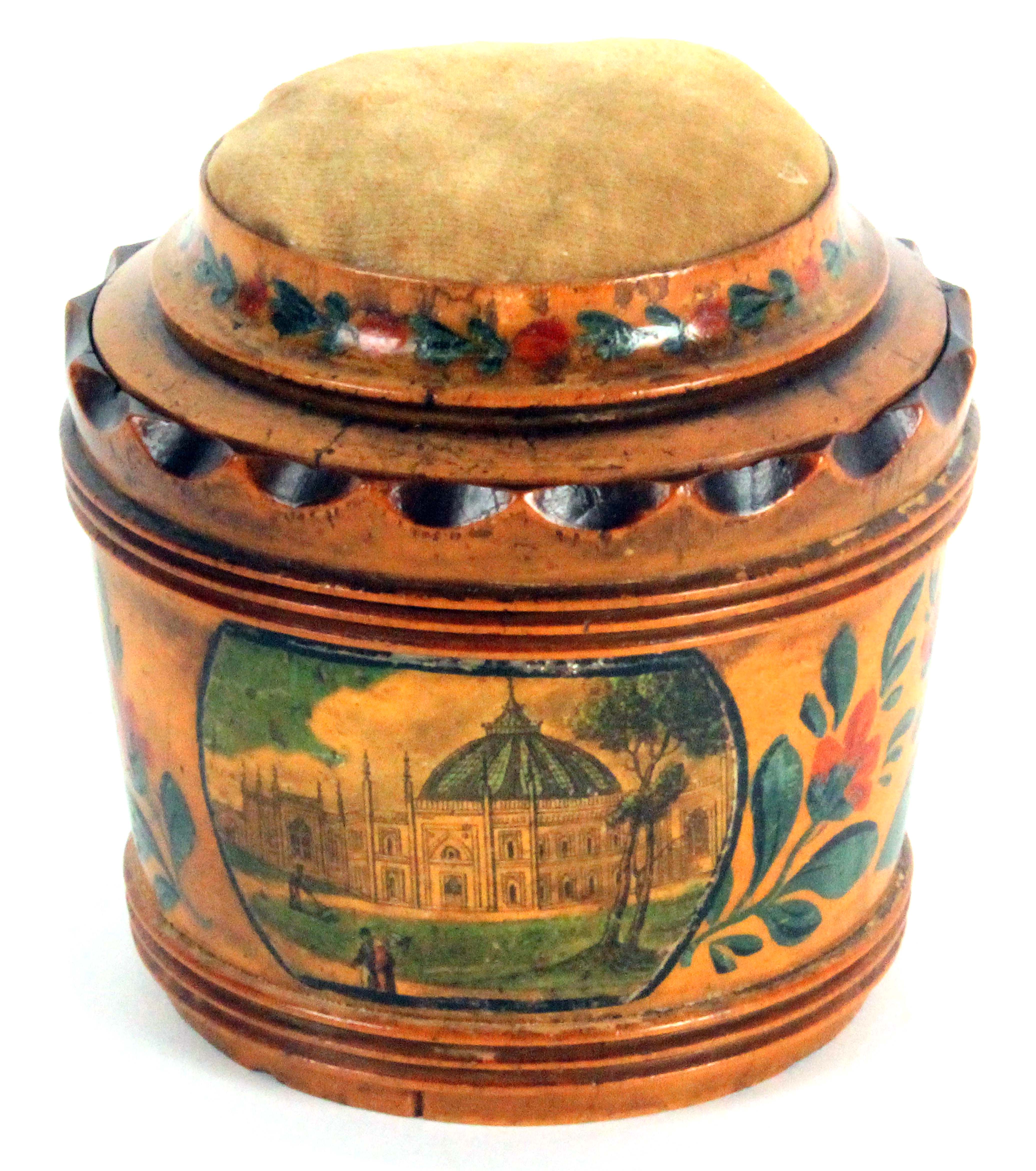 An early Tunbridge ware white wood box base pin cushion, of tapering cylinder form, brightly painted