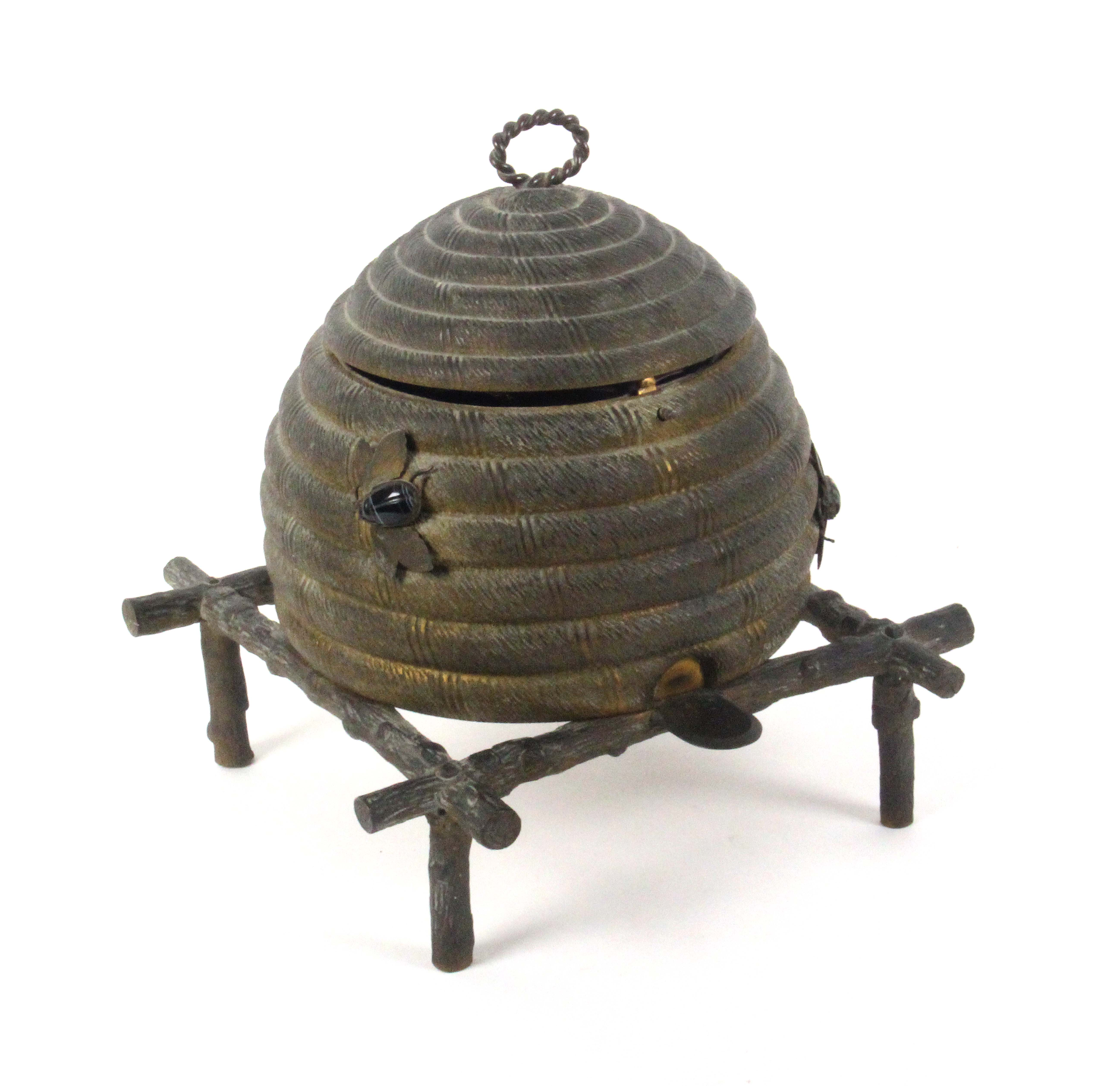 An unusual gilt metal sewing casket in the form of a bee skep, circa 1870, the surface dull,