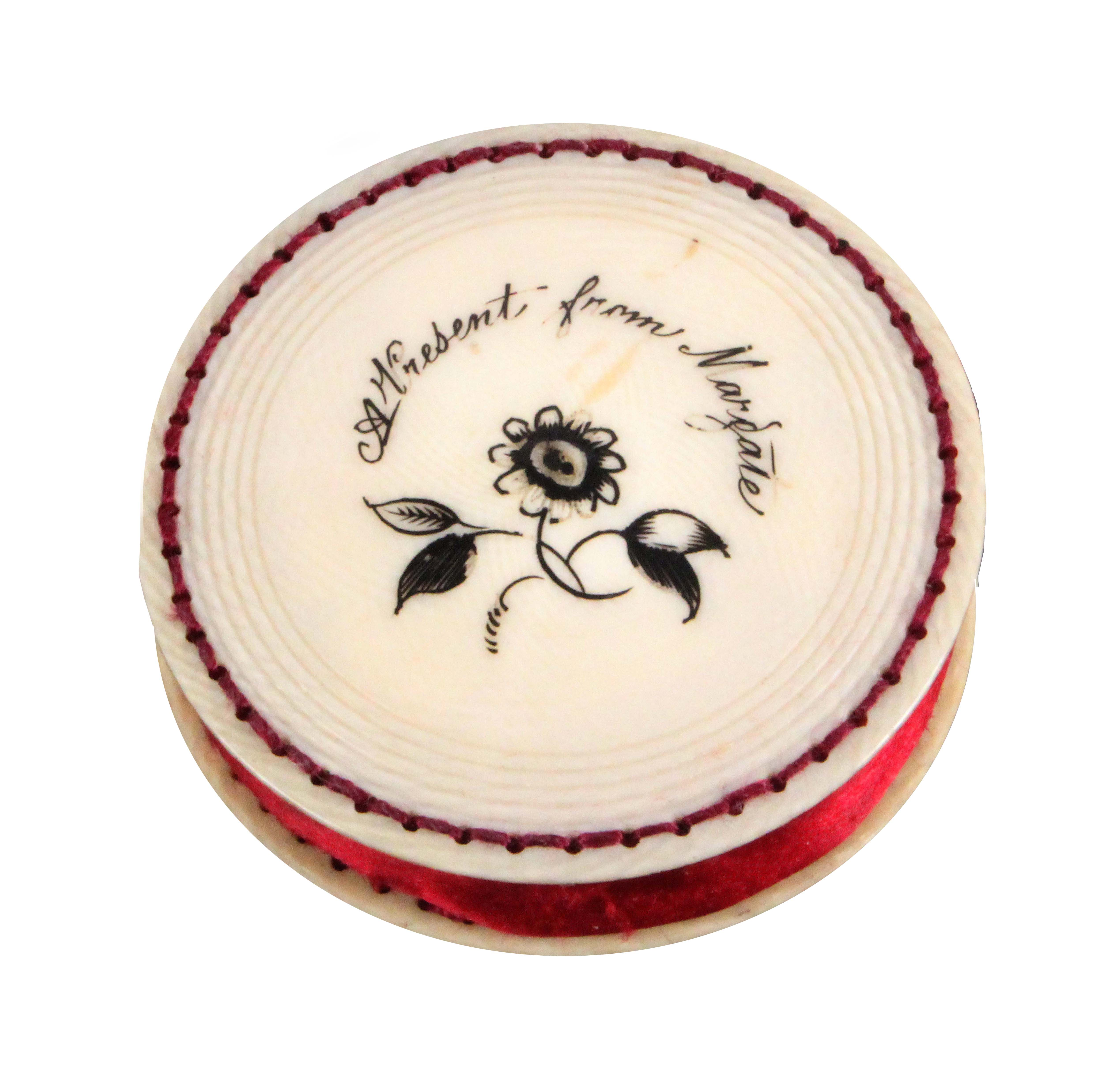 A rare early 19th Century ivory disc form pin cushion, one side engraved with a flowering branch and