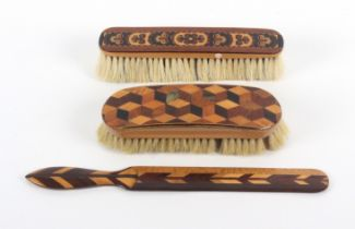 Tunbridge ware - three pieces, comprising a curved top brush with cube work panel, some bristles